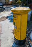 Yellow mail box in Cyprus Stock Image