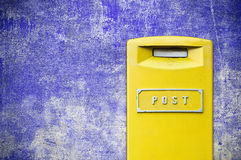 Yellow mail-box over grunge background Royalty Free Stock Photography