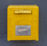 Yellow mail box on the wall Stock Images