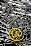 Yellow mail paper clip Stock Images