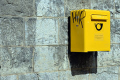 Yellow mailbox Stock Images