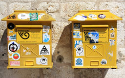 Yellow mailbox. CROATIA. DUBROVNIK - JUNE 20, 2017: Two modern yellow mailboxes hang on an old city wall on a summer day Stock Image