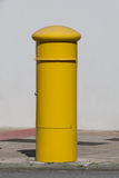 Yellow mailbox on the street Stock Images