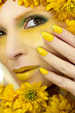 Yellow makeup and manicure. Stock Photography