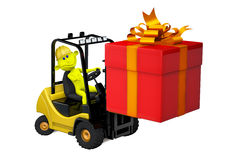 Yellow man on a loader with a gift by a holiday Stock Photos