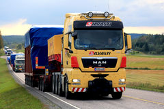 Yellow MAN Semi Leads Convoy of Oversize Load Transports royalty free stock image