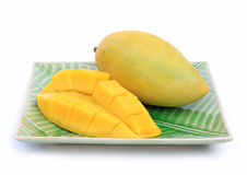 Yellow mango. On plate on white background Royalty Free Stock Photo