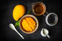 Free Yellow Mango Peel In The Cup And Honey And Coconut Milk Royalty Free Stock Image - 118208366