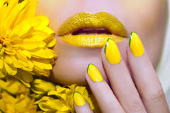 Yellow manicure and makeup . royalty free stock photography