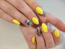 Yellow manicure nail design royalty free stock images