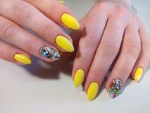 Yellow manicure nail design stock image