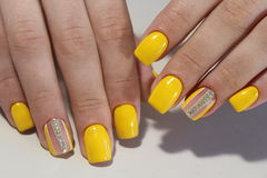 Yellow manicure nail design with stones stock images