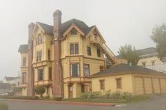 Yellow mansion, Victorian style Stock Photos