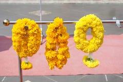 Yellow marigold flower garland. Close up yellow marigold flower garland stock image