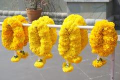 Yellow marigold flower garland. Close up yellow marigold flower garland stock photos