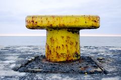 Yellow marine puller. In a pier in a port stock images