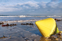 Yellow Marker Buoy at Low Tide on a Wet Sand Beach Stock Photos
