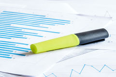 Yellow marker on a paper diagram. Yellow marker on a paper with a blue diagram Royalty Free Stock Photos