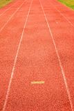 Yellow marks. White lines and texture of running racetrack, red racetrack,  in outdoor stadium Stock Photos