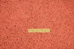 Yellow marks. White lines and texture of running racetrack, red racetracks in outdoor stadium Royalty Free Stock Images