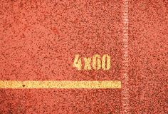 Yellow marks. White lines and texture of running racetrack, red racetracks in outdoor stadium Stock Photos