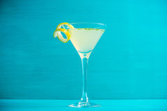 Yellow martini cocktail with lemon and mint. On the rustic wooden background Stock Photos