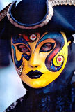 Yellow Mask. Person in a Venitial carnival mask stock photo