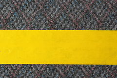 Yellow masking tape on the carpet Royalty Free Stock Image
