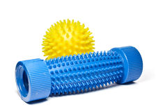 Yellow massage ball with a blue foot massager. Royalty Free Stock Photography
