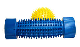 Yellow massage ball with a blue foot massager. Stock Photos