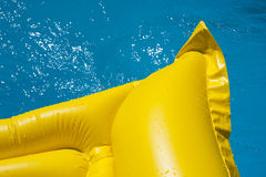 Yellow mat in the pool Stock Photography