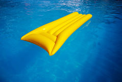 Yellow mattress in the swimming pool Royalty Free Stock Image