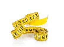 Yellow measure tape. Stock Photo
