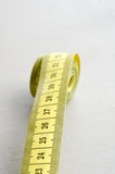 Yellow measure tape Stock Photography