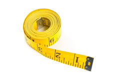 Yellow measure tape on white background Royalty Free Stock Image