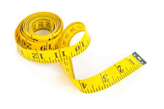 Yellow measure tape on white background Stock Photography