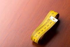 Yellow measurement tape Royalty Free Stock Photos