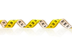 Yellow measuring tape. Isolated on white background Royalty Free Stock Image