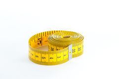 Yellow Measuring Tape. Roll of yellow measuring tape over white background Stock Images