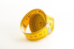 Yellow Measuring Tape. Roll of yellow measuring tape over white background Royalty Free Stock Photos