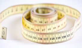 A yellow measuring tape. Royalty Free Stock Image