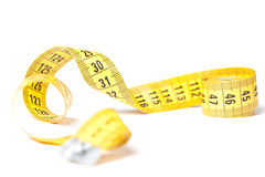 Yellow measuring tape. Isolated over white background stock photography