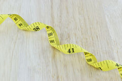 Yellow measuring tape concept for healthy diet and weight contro Stock Image