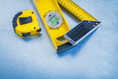 Yellow measuring tape construction level and Stock Photography