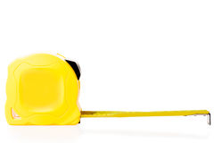 The yellow measuring tape isolated Royalty Free Stock Images