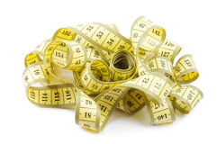 Yellow measuring tape isolated on white Royalty Free Stock Photography