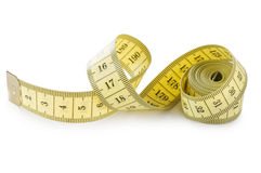 Yellow measuring tape isolated on white Stock Image
