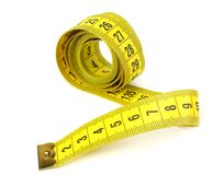 Yellow measuring tape isolated on white background stock photography