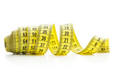 The yellow measuring tape. Stock Images