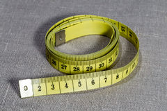 Yellow measuring tape Royalty Free Stock Photography